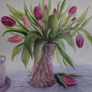 Tulips in pink glass vase